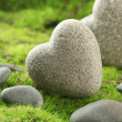 Stock Photo: Grey stones in shape of heart, on grass background