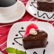 Sweet cakes with chocolate on plate on table close-up — Stock Photo #40392209