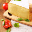 Stock fotografie: Tasty Camembert cheese with tomatoes and basil, on wooden table