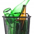 Stock Photo: Glass bottles in recycling bin isolated on white
