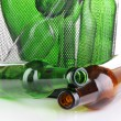 Stock Photo: Glass bottles in recycling bin close up