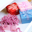 Gift boxes and beads in open desk drawer close up — Stock Photo