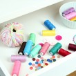 Stock Photo: Sewing accessories in open drawer close up