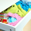 Open drawer with clothes close up — Stock Photo #40395243
