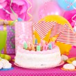 Festive table setting for birthday on celebratory decorations — Stock Photo #40396549