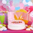 Festive table setting for birthday on celebratory decorations — Stock Photo #40396551