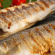 Delicious grilled fish on wok close-up — Stock Photo #40396847