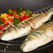Delicious grilled fish on wok close-up — Stock Photo #40396863
