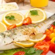 Stock fotografie: Delicious grilled fish on plate on table close-up