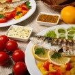 图库照片: Delicious grilled fish on plate on table close-up