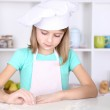 Little girl preparing cookies in kitchen at home — Stock Photo #40397651