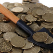 Stock fotografie: Coins with shovel close up