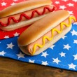 Stock fotografie: Tasty hot dogs on napkin with stars