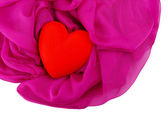 Decorative red heart, on color fabric, isolated on white — Stock Photo