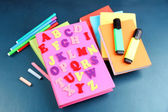 English alphabet, books and markers on school desk — Stock Photo