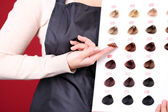 Hair stylist with hair samples of different colors, close-up — Stock Photo