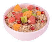 Delicious oatmeal with fruit in bowl isolated on white — Stock Photo