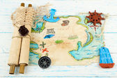 Treasure map with sea accessories, on wooden background — Stock Photo