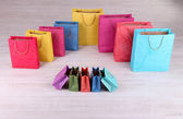 Colorful shopping bags, on light background — Foto de Stock