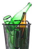 Glass bottles in recycling bin isolated on white — Stock Photo
