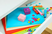 Colorful paper in open desk drawer close up — Stock Photo