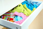 Open drawer with clothes close up — Stock Photo