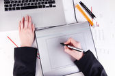 Female hand using graphics tablet on table close up — Stock Photo