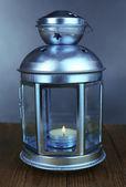 Decorative metallic lantern on wooden table on grey background — Stock Photo