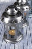 Decorative metallic lanterns on wooden background — Stock Photo