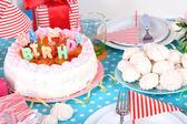 Festive table setting for birthday on celebratory decorations — Foto de Stock