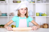 Little girl preparing cake dough in kitchen at home — Stock Photo