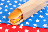 Tasty hot dog on napkin with stars — Stock Photo