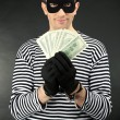 Stock Photo: Thief on dark background