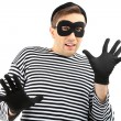 Stock Photo: Thief isolated on white