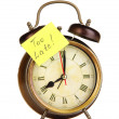 Stock fotografie: Alarm clock with sticker isolated on white