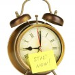 Alarm clock with sticker isolated on white — Stock Photo #40404773