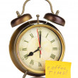 Alarm clock with sticker isolated on white — Stock Photo #40404793