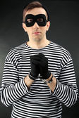 Thief with handcuffs on dark background — Stock Photo