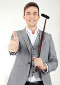 Elegant young businessman playing mini golf at home — Stockfoto