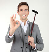Businessman posing with golf club isolated on white — Stock Photo