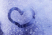 Drawn heart on wet window close-up — Stock Photo