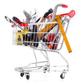 Construction tools in shopping cart isolated on white — Stock Photo