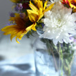 Bouquet of wild flowers in glass vase on napkin close-up — Stock Photo