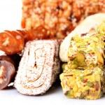 Tasty oriental sweets (Turkish delight), isolated on white — Stock Photo #40437039
