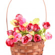 Bouquet of beautiful artificial flowers in wicker basket, isolated on white — Stock Photo