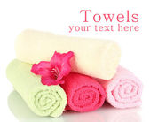 Bright towels and flower isolated on white — ストック写真