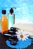 Beautiful spa setting on bamboo mat on bright background — Stock Photo