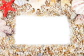 Frame of small sea stones and shells, isolated on white — Stock Photo