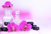 Beautiful spa setting with orchid on white wooden table on bright background — Stock Photo