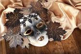 Mask on golden fabric — Stock Photo